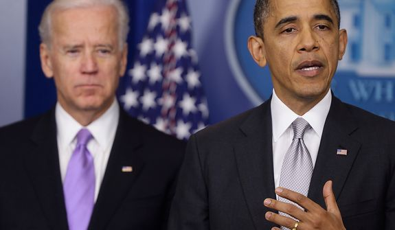 President Barack Obama stands with Vice President Joe Biden as he makes a statement in the Brady Press Briefing Room about policies he will pursue following the Newtown, Conn., school shootings, Wednesday, Dec. 19, 2012, at the White House in Washington. (AP Photo/Charles Dharapak)