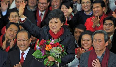 South Korean presidential candidate Park Geun-Hye of the ruling Saenuri Party waves to supporters after arriving at the party headquarters in Seoul on Wednesday, Dec. 19, 2012. (AP Photo/Kim Jae-hwan, Pool)