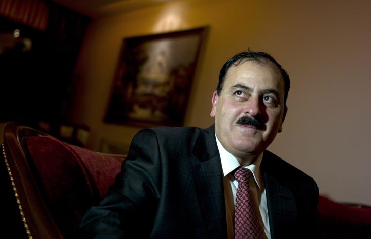 Gen. Salim Idris, who defected from the Syrian army in July, speaks during an interview in Antakya, Turkey, on Tuesday, Dec. 18, 2012. (AP Photo/Bela Szandelszky)