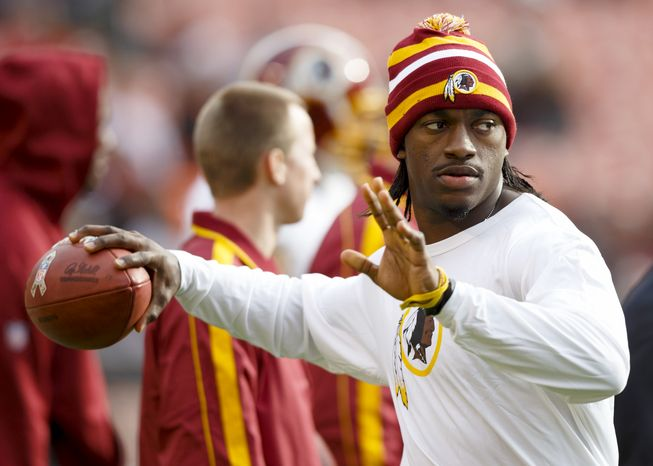 Washington Redskins quarterback Robert Griffin III before an NFL football game against the Cleveland Browns in Cleveland, Sunday, Dec. 16, 2012. (AP Photo/Rick Osentoski)
