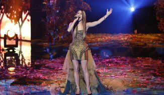 """This Monday, Dec. 17, 2012, file photo released by NBC shows Cassadee Pope performing on """"The Voice,"""" """"Live Show"""" Episode 323A on the part one season 3 finale in Los Angeles. (AP Photo/NBC, Tyler Golden)"""