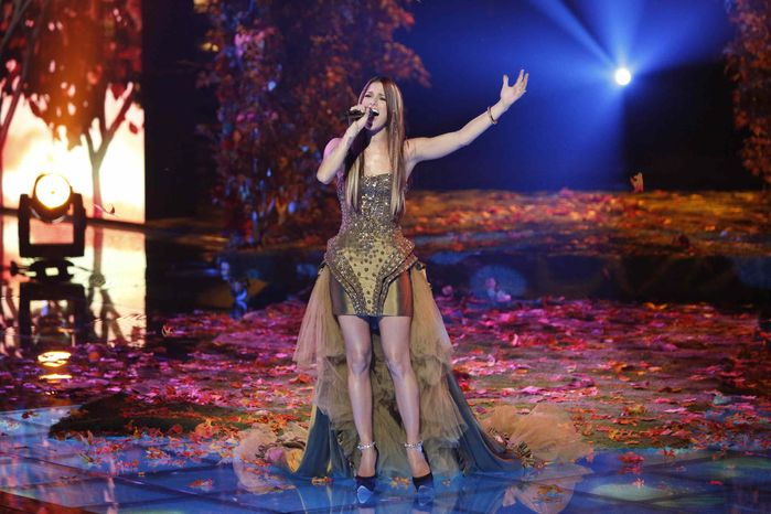 """This Monday, Dec. 17, 2012, file photo released by NBC shows Cassadee Pope performing on """"The Voice,"""" """"Live Show"""" Episode 323A on the part one season 3 finale"""