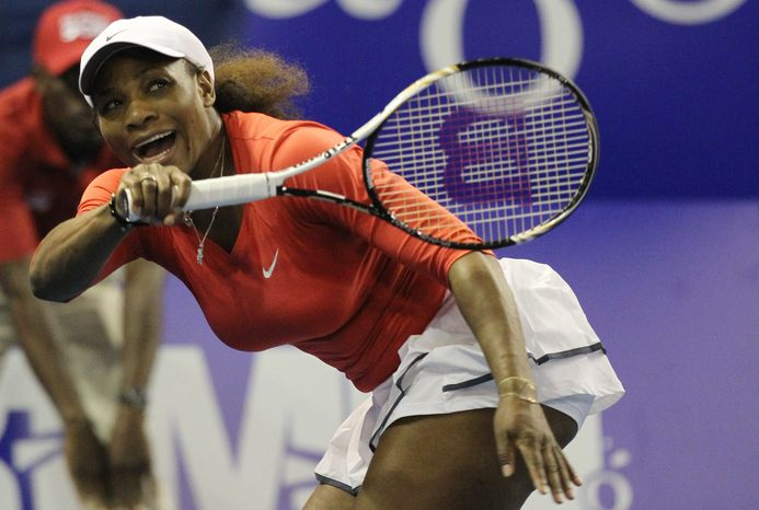 """FILE - In this Nov. 4, 2012, file photo, Serena Williams of the U.S. returns a serve from sister Venus during an exhibition tennis match at Ellis Park Indoor Arena in Johannesburg, South Africa. Williams has had surgery on her big toes and withdrew from an exhibition match against top-ranked Victoria Azarenka in Thailand in December. A medical certificate from Florida podiatrist Jeffrey Rockefeller says Williams """"was treated for a chronic foot disorder which involved minor procedures on both of her great toes."""" (AP Photo/Themba Hadebe, File)"""