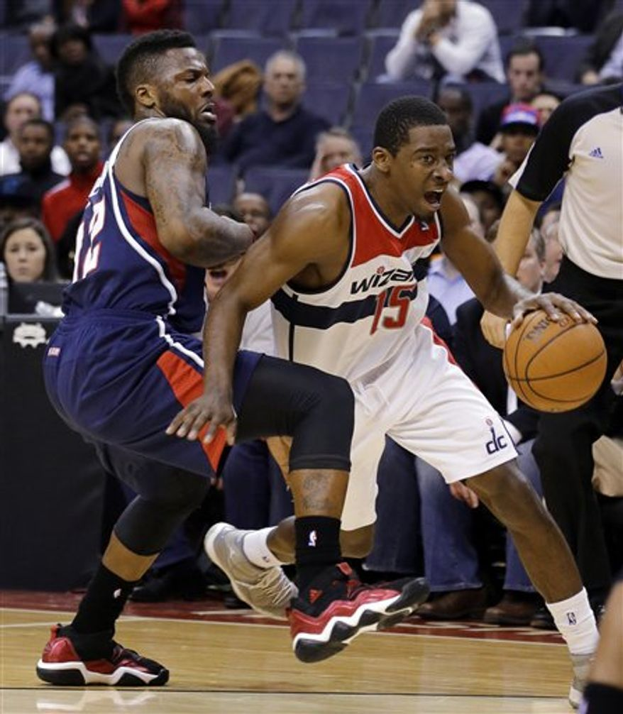 Washington Wizards guard Jordan Crawford drives around Atlanta Hawks guard DeShawn Stevenson during overtime of an NBA basketball game Tuesday, Dec. 18, 2012, in Washington. Crawford scored 27 points, but the Hawks won 100-95 in overtime. (AP Photo/Alex Brandon)