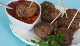 Cranberry marinara gives these meatballs a sweet and tangy taste. (Associated Press)