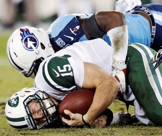 Quarterback Tim Tebow has been grounded with the Jets, not having the chance to re-create the magic that made him a household word last year when he played with the Broncos. Denver traded him to New York after signing Peyton Manning to be its starter. (Associated Press)