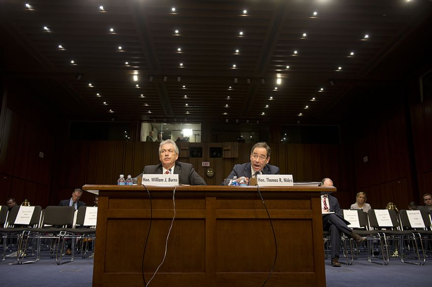 Deputy Secretary of State William J. Burns (left) and Thomas R. Nides, deputy secretary of state for management and resources, speak before the Senate Foreign Relations Committee at a hearing on Thursday, Dec. 20, 2012, on the Benghazi attack. (Barbara L. Salisbury/The Washington Times)