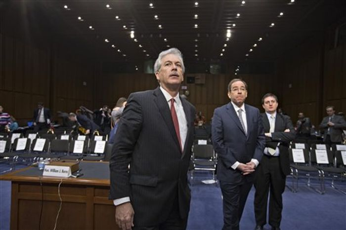 Deputy Secretary of State William J. Burns (left), who is in charge of policy, and Deputy Secretary of State Thomas Nides (second from left), who is in charge of management, leave a hearing room on Capitol Hill in Washington on Thursday, Dec. 20, 2012, after testifying before the Senate Foreign Relations Committee about the attack on the U.S. Co