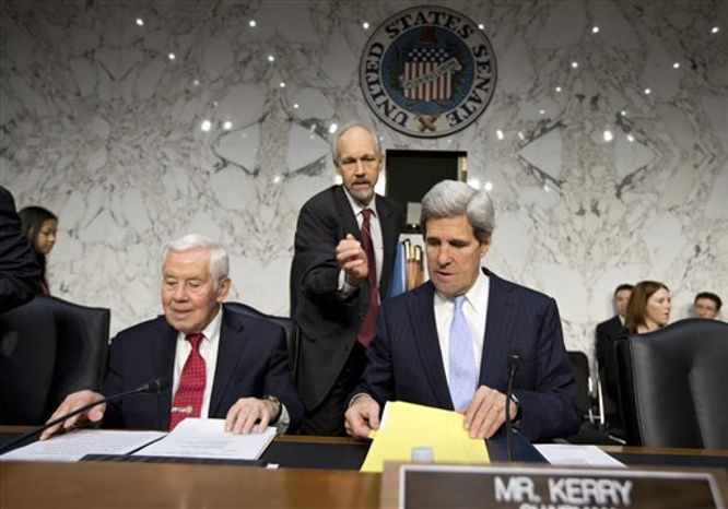 Sen. John F. Kerry, Massachusetts Democrat, who is chairman of the Senate Foreign Relations Committee, leads a hearing on the attack on the U.S. Consulate in Benghazi, Libya, where the ambassador and three other Americans were killed Sept. 11, on Capitol Hill in Washington on Thursday, Dec. 20, 2012. Sen. Richard G. Lugar (left), Indiana Republican, is the ranking GOP member on the panel.  (AP Photo/J. Scott Applewhite)