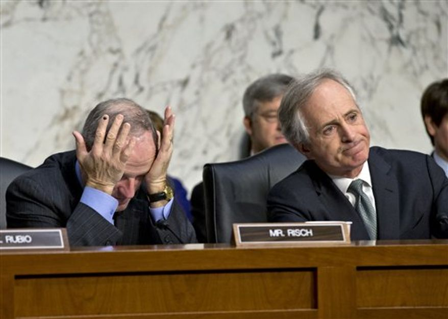 Sen. Bob Corker, R-Tenn., right, and Sen. James Risch, R-Idaho, left, listen to testimony from State Department officials after an independent review panel said this week that serious bureaucratic mismanagement was responsible for inadequate security at the mission in Benghazi, Libya, where the U.S. ambassador and three other Americans were killed on Sept. 11, on Capitol Hill in Washington, Thursday, Dec. 20, 2012. Deputy Secretary of State Thomas Nides, who is in charge of management, and State Department Deputy Secretary of State William Burns, who is in charge of policy, appeared in place of Secretary of State Hillary Rodham Clinton who had been scheduled to testify but canceled after fainting and sustaining a concussion last week. (AP Photo/J. Scott Applewhite)