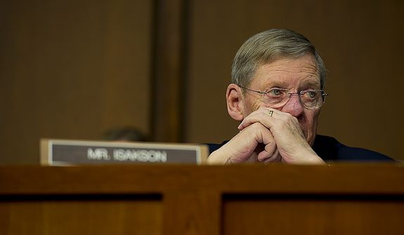 Sen. Johnny Isakson (R-GA), a member of the Senate Foreign Relations Committee , listens to testimony during a hearing Thursday, Dec. 20, 2012 on the Benghazi attack. William J. Burns, deputy secretary of state, and Thomas R. Nides, deputy secretary of  state for management and resources, were witnesses. (Barbara L. Salisbury/The Washington Times)