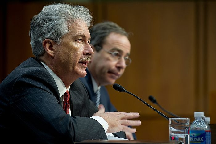 """William J. Burns, left, deputy secretary of state, testifies before the Senate Foreign Relations Committee at a hearing Thursday, Dec. 20, 2012 on the Benghazi attack. Burns reiterated that immediately following the attack Secretary of State Hillary Clinton labeled it an """"act of terror."""" (Barbara L. Salisbury/The Washington Times)"""