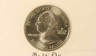 This undated photo provided on Wednesday, Dec. 19, 2012, by the U.S. Mint in Philadelphia shows a bonneted Martha Washington on a nonsense test piece. The Mint has been testing different materials to fiend less expensive ways to make coins. (AP Photo U.S. Mint)