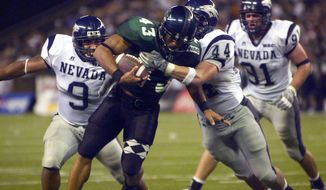 ** FILE ** In this Oct. 9, 2004, file photo, Hawaii's Bryan Maneafaiga (43) scores a touchdown against Nevada in Honolulu. (AP Photo/ Honolulu Star-Advertiser, George F. Lee)