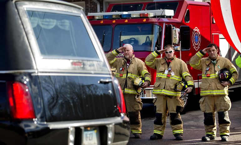 Firefighters salute as a hearse passes for the funeral procession to the burial of 7-year-old Sandy Hook Elementary School shooting victim Daniel Gerard Barden, Wednesday, Dec. 19, 2012, in Newtown, Conn. Barden was killed when Adam Lanza walked into Sandy Hook Elementary School in Newtown, Conn., Dec. 14, and opened fire, killing 26 people, including 20 children, before killing himself. (AP Photo/David Goldman)