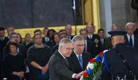 Sens. Harry Reid, left, and Mitch McConnell present a wreath during a memorial service for the late Sen. Daniel Inouye at the U.S. Capitol rotunda on Thursday, Dec. 20, 2012. Sen. Inouye, who served as a U.S. senator for 50 years, is only the 31st person to lie in state in the rotunda of the U.S. Capitol. It is seen as a sign of respect. (Barbara L. Salisbury/The Washington Times)