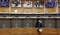 FILE -In this Sept. 25, 2012 file photo, an empty locker room is shown during the NHL labor lockout at the First Niagara Center, home of the Buffalo Sabres hockey team, in Buffalo, N.Y. The NHL lockout that's already wiped out the first three months of the season is taking its toll on Buffalo businesses. And it's no different in many of the NHL's 29 other markets. (AP Photo/David Duprey, File)