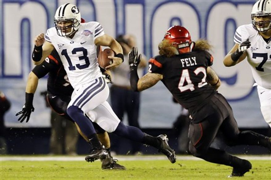 BYU quarterback Riley Nelson scrambles for a 13-yard gain and a first down against San Diego State during the first half of the Poinsettia Bowl college football game, Thursday, Dec. 20, 2012, in San Diego. (AP Photo/Lenny Ignelzi)