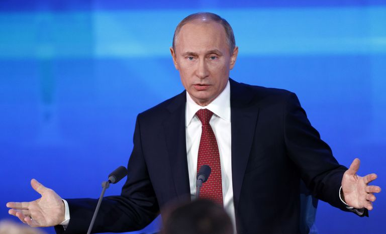 Russian President Vladimir Putin speaks during his annual hours-long news conference in Moscow on Thursday, Dec. 20, 2012. (AP Photo/Alexander Zemlianichenko)