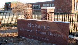 This Monday, Dec. 17, 2012, photo shows the sign in front of the Harrold Independent School District in Harrold, Texas. The K-12 school has a policy allowing teachers and other school employees to carry concealed weapons, a controversial policy that's now being considered in at least five other states in the wake of last week's deadly elementary school shooting in Newtown, Conn. (AP Photo/Angela K. Brown)
