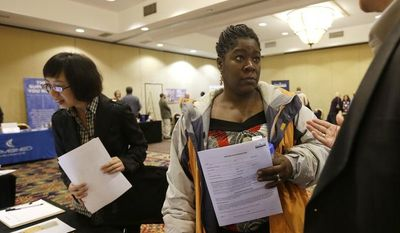 Angela Winters (center) of Schenectady, N.Y., talks with a recruiter during a job fair at the Marriott Hotel in Colonie, N.Y., on Thursday, Oct. 25, 2012. (AP Photo/Mike Groll)