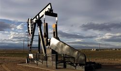 "** FILE ** This Dec. 5, 2012, photo shows an oil pump jack in a field adjacent to a sub-division near Fredrick, Colo. Citizen fears about hydraulic fracturing, a drilling procedure used to pry oil and gas from rock deep underground, have made ""fracking"" the hottest political question in Colorado."