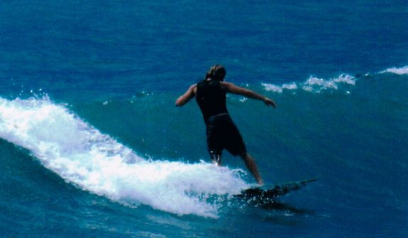 Former Marine Jon Hammar, who served combat tours in Afghanistan and Iraq, was arrested for illegally possessing an antique firearm even though he declared the gun to Mexican Customs agents. He is shown during surfing in Costa Rica in 2007. He could face up to 15 years in prison if convicted. (Photo courtesy Olivia Hammar)