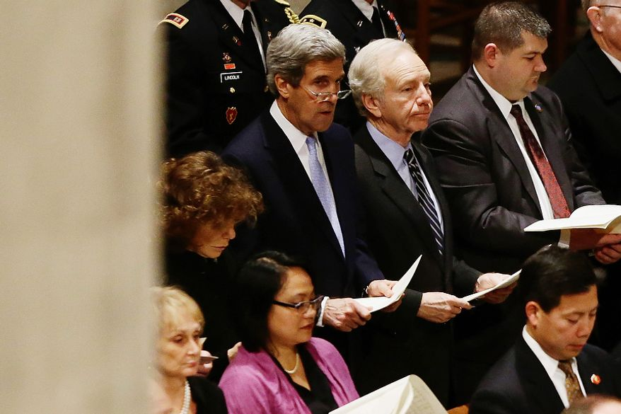 Sen. John Kerry, D-Mass., stands with Sen. Joe Lieberman, I-Conn., as they attend with President Barack Obama, not pictured, the funeral service for the late Sen. Daniel Inouye, D-Hawaii, at the Washington National Cathedral, Friday, Dec. 21, 2012. (AP Photo/Charles Dharapak)