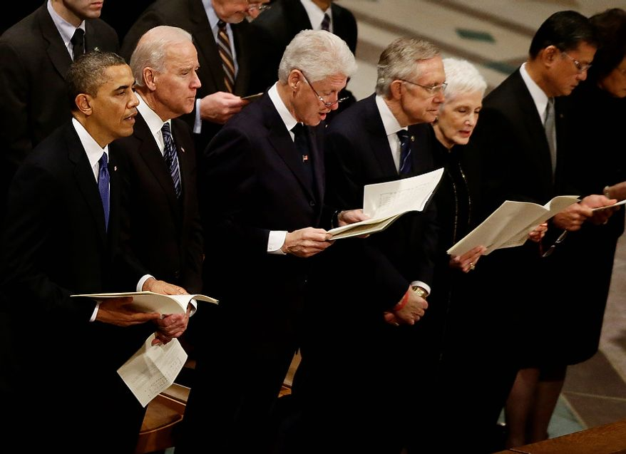 President Barack Obama, Vice President Joe Biden, former President Bill Clinton, and Senate Majority Leader Harry Reid of Nevada stand and sing at the funeral service for the late Sen. Daniel Inouye, D-Hawaii, at the Washington National Cathedral, Friday, Dec. 21, 2012. (AP Photo/Charles Dharapak)