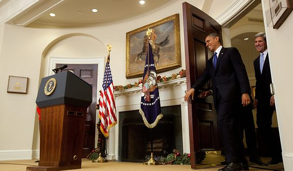 President Barack Obama enters the Roosevelt Room with Sen. John Kerry, D-Mass., his choice to be the next Secretary of State,  before he makes his announcement at the White House in Washington, Friday, Dec. 21, 2012. (AP Photo/Carolyn Kaster)