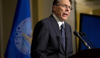 "The National Rifle Association Executive Vice President Wayne LaPierre speaks during a news conference in response to the Connecticut school shooting on Friday, Dec. 21, 2012, in Washington. The nation's largest gun-rights lobby is calling for armed police officers to be posted in every American school to stop the next killer ""waiting in the wings."" (AP Photo/ Evan Vucci)"