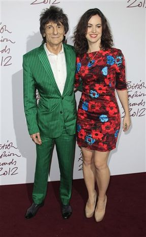 Ronnie Wood and his fiancee Sally Humphreys arrive for the British Fashion Awards at the Savoy Hotel in central London, Tuesday Nov. 27, 2012. (Photo by Joel Ryan/Invision/AP)