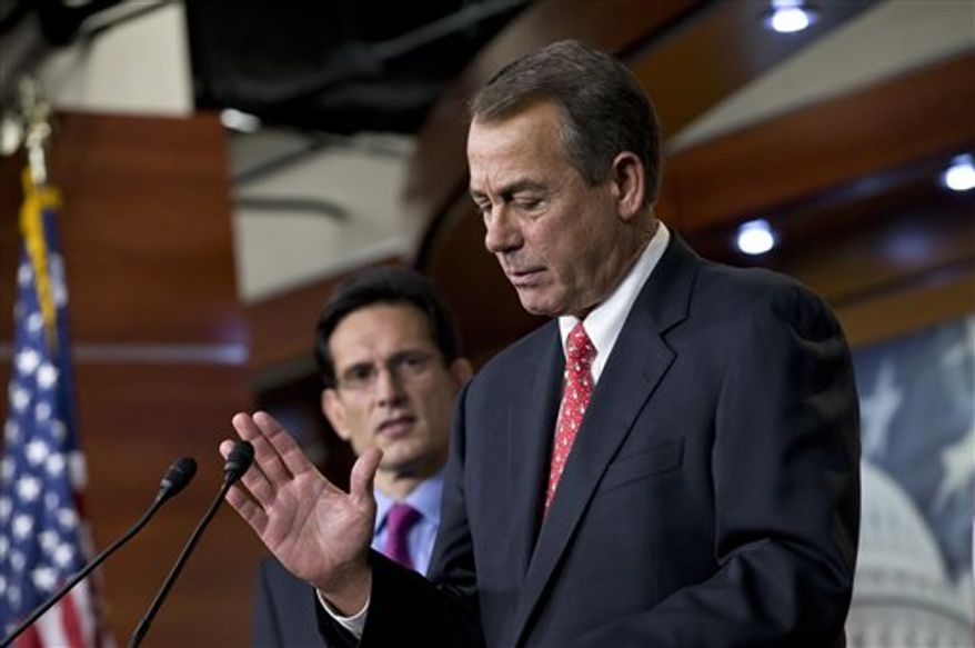 "House Speaker John A. Boehner, Ohio Republican, joined by House Majority Leader Eric Cantor (left), Virginia Republican, speaks to reporters about the ""fiscal cliff"" negotiations at the Capitol in Washington on Friday, Dec. 21, 2012. (AP Photo/J. Scott Applewhite)"