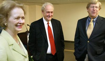 UPI FILE Robert Bork (center) is shown with his wife and former solicitor general Theodore Olson in 2005. **FILE PHOTO**