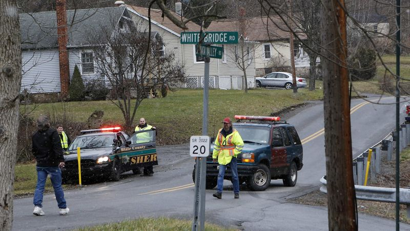 Emergency responders block Juniata Valley Road on Friday, Dec. 21, 2012, in Geeseytown, Pa. A man fatally shot a woman decorating for a children's Christmas party at a tiny church hall and killed two men elsewhere in the rural centr