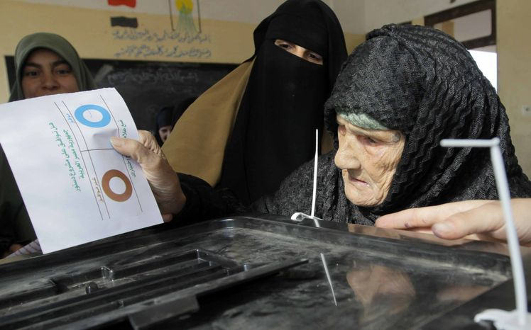 Amnah Sayyed Moussa, 85, casts her vote in the second round of a referendum on a disputed constitution drafted by Islamist supporters of Egyptian President Mohammed Morsi in Giza, Egypt, on Saturday, Dec. 22, 2012. (AP Photo/Amr Nabil)