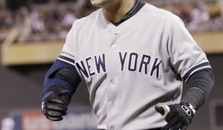 New York Yankees' Nick Swisher celebrates his two-run home run off Minnesota Twins pitcher Esmerling Vasquez in the fourth inning of a baseball game Tuesday, Sept. 25, 2012 in Minneapolis. (AP Photo/Jim Mone)