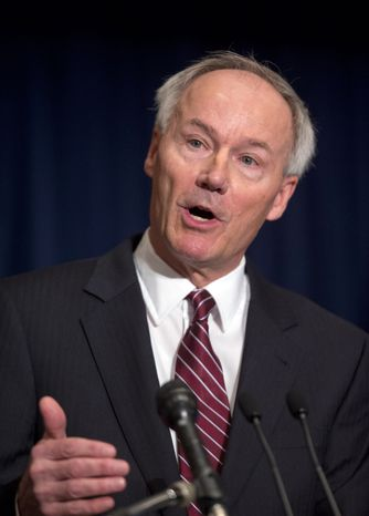 Former Rep. Asa Hutchinson, Arkansas Republican, speaks during a news conference in response to the Connecticut school shooting on Friday, Dec. 21, 2012, in Washington. Mr. Hutchinson will lead a National Rifle Association program that will develop a model security plan for schools that relies on armed volunteers. (AP Photo/Evan Vucci)