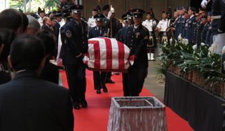 Pallbearers carry the casket of U.S. Sen. Daniel K. Inouye into the courtyard of the Hawaii Capitol during a visitation ceremony in Honolulu on Saturday, Dec. 22, 2012. (AP Photo/Oskar Garcia)