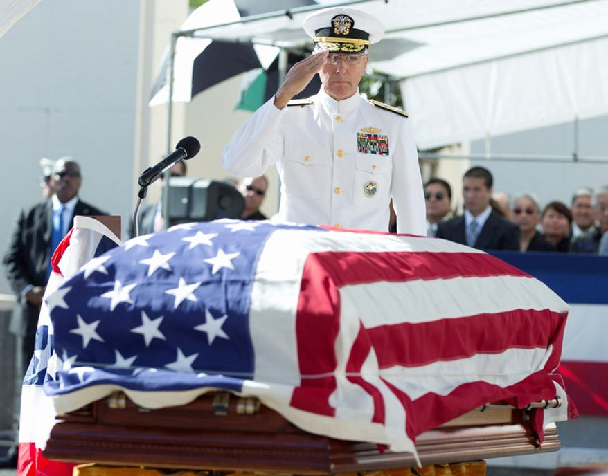Adm. Samuel Locklear, III, commander of the Navy's U.S. Pacific Command, salutes the flag-draped casket of the late Sen. Daniel Inouye, D-Hawaii, during a memorial service at the National Memorial Cemetery of the Pacific, Sunday, Dec. 23, 2012, in Honolulu. Inouye, D-Hawaii, died Dec. 17. He was 88. (AP Photo/Carolyn Kaster)