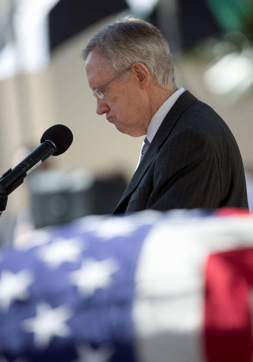 Senate Majority Leader Harry Reid of Nevada pauses as he speaks next to the flag-draped casket of  the late Sen. Daniel Inouye, D-Hawaii, during a memorial service at the National Memorial Cemetery of the Pacific, Sunday, Dec. 23, 2012, in Honolulu. (AP Photo/Carolyn Kaster)