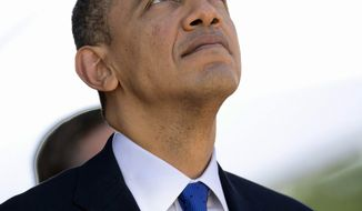 President Barack Obama looks to the sky during a fly over at the memorial service for the late Sen. Daniel Inouye, D-Hawaii, at the National Memorial Cemetery of the Pacific, Sunday, Dec. 23, 2012, in Honolulu. Inouye was the first Japanese-American elected to both houses of Congress and the second-longest serving senator in U.S. history. (AP Photo/Carolyn Kaster)