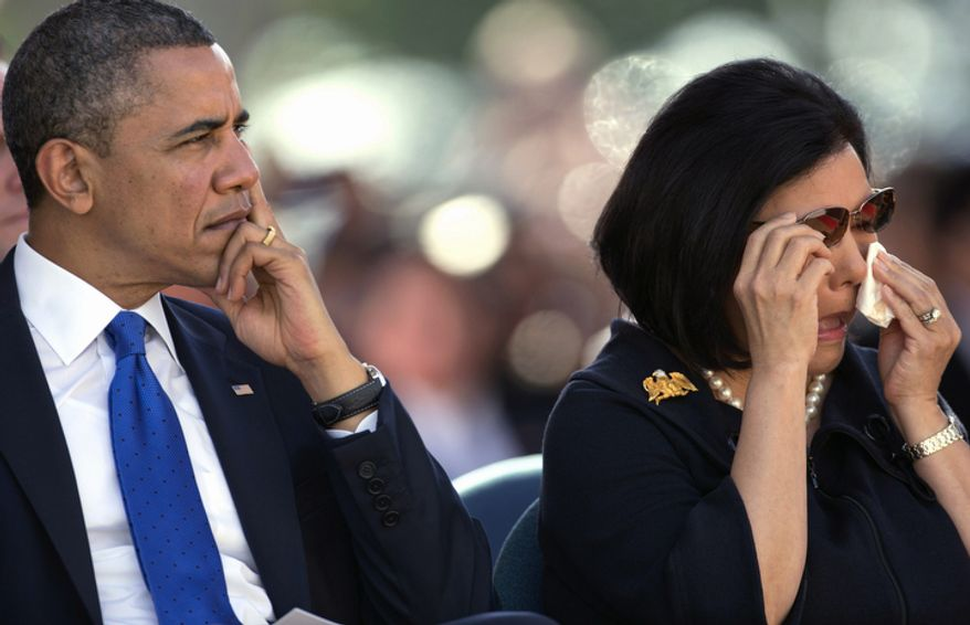 During a memorial service for the late Sen. Daniel Inouye, D-Hawaii, President Barack Obama, left, sits next to Irene Hirano Inouye, the widow of the late Sen. Daniel Inouye, at the National Memorial Cemetery of the Pacific, Sunday, Dec. 23, 2012, in Honolulu. Inouye was the first Japanese-American elected to both houses of Congress and the second-longest serving senator in U.S. history. (AP Photo/Carolyn Kaster)