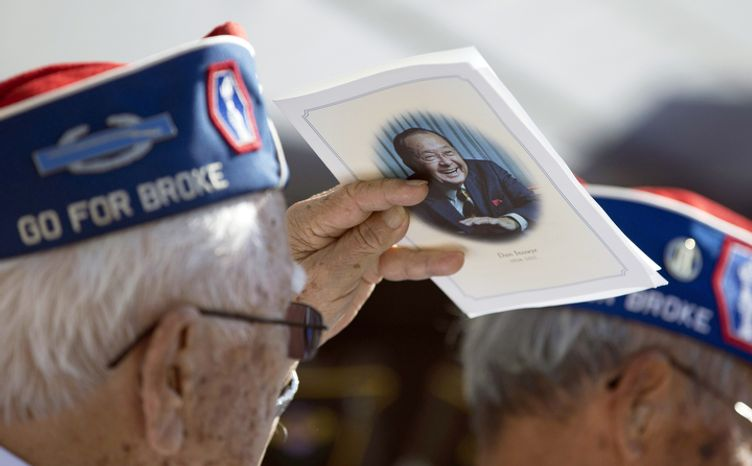 World War II veterans of the U.S. Army 422nd Regimental Combat Team attend a memorial for the late Sen. Daniel Inouye, D-Hawaii, at the National Memorial Cemetery of the Pacific, Sunday, Dec. 23, 2012, in Honolulu. (AP Photo/Carolyn Kaster)