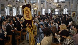 **FILE** Syrian Orthodox Christians attend Easter Mass in Damascus, Syria, on Sunday, April 15, 2012. Christians, who make up about 10 percent of Syria's population of more than 22 million, say they are particularly vulnerable to the violence that has been sweeping the country since March 2011. They are fearful that the country will become another Iraq, with Christians caught in the crossfire between rival Islamic groups. (AP Photo/Bassem Tellawi)