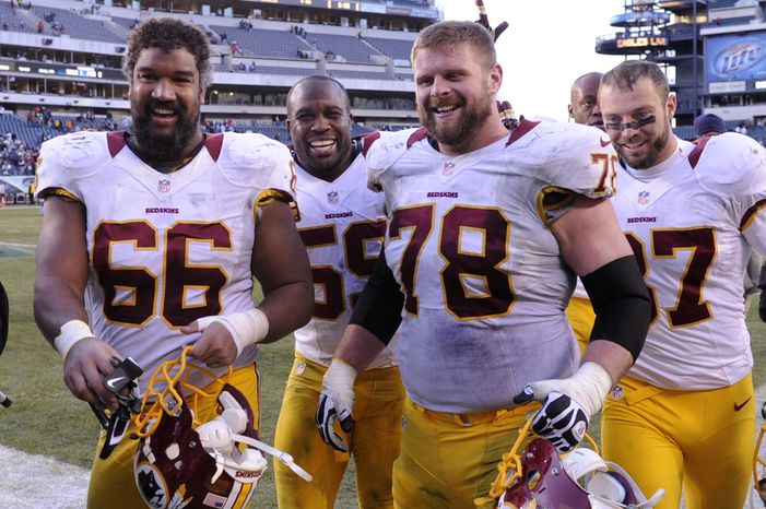 Washington Redskins Chris Chester (66), London Fletcher (59),  Kory Lichtensteiger (78), and Reed Doughty (37) leave the field all smiles after defeating the Eagles 27-20 at Lincoln Financial Field, Philadelphia, Pa., Dec. 23, 2012. (Preston Keres/Special to The Washington Times)