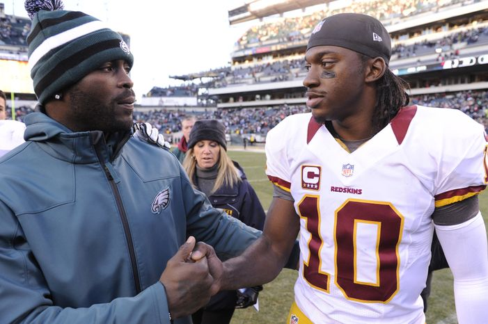 Philadelphia Eagles quarterback Michael Vick (L) talks with Washington Redskins quarterback Robert Griffin III (10) after the game at Lincoln Financial Field, Philadelphia, Pa., Dec. 23, 2012. (Preston Keres/Special to The Washington Times)