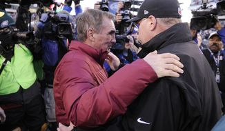 Washington Redskins head coach Mike Shanahan (L) greets Philadelphia Eagles head coach Andy Reid at midfield after a 27-20 Redskins victory at Lincoln Financial Field, Philadelphia, Pa., Dec. 23, 2012. (Preston Keres/Special to The Washington Times)