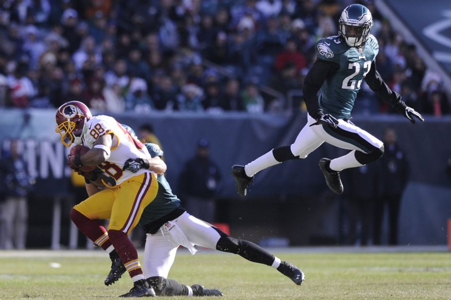Washington Redskins wide receiver Pierre Garcon (88) hauls in a first down reception in the first quarter as Philadelphia Eagles cornerback Dominique Rodgers-Cromartie (23) flies by at Lincoln Financial Field, Philadelphia, Pa., Dec. 23, 2012. (Preston Keres/Special to The Washington Times)
