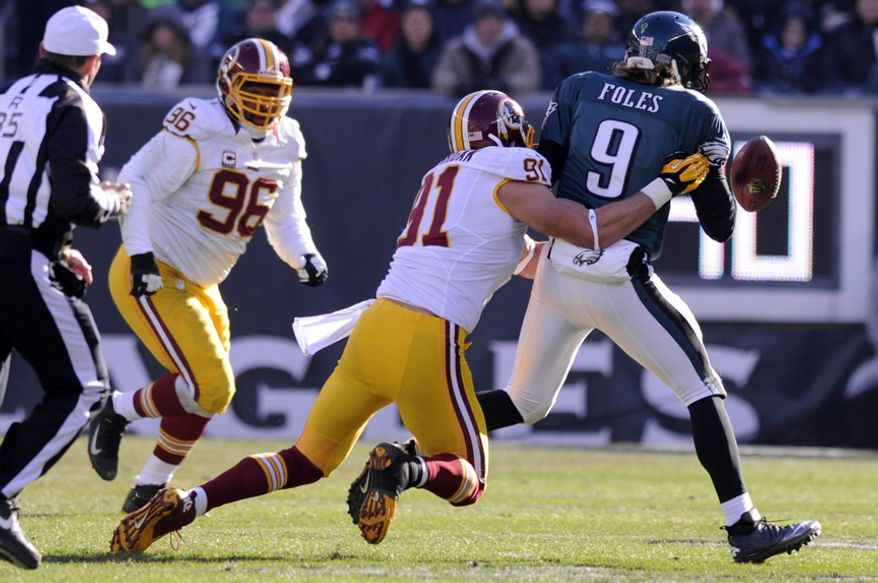 ** FILE ** Washington Redskins outside linebacker Ryan Kerrigan (91) sacks Philadelphia Eagles quarterback Nick Foles (9) and forces a fumble for a turnover in the second quarter at Lincoln Financial Field, Philadelphia, Pa., Dec. 23, 2012. (Preston Keres/Special to The Washington Times)